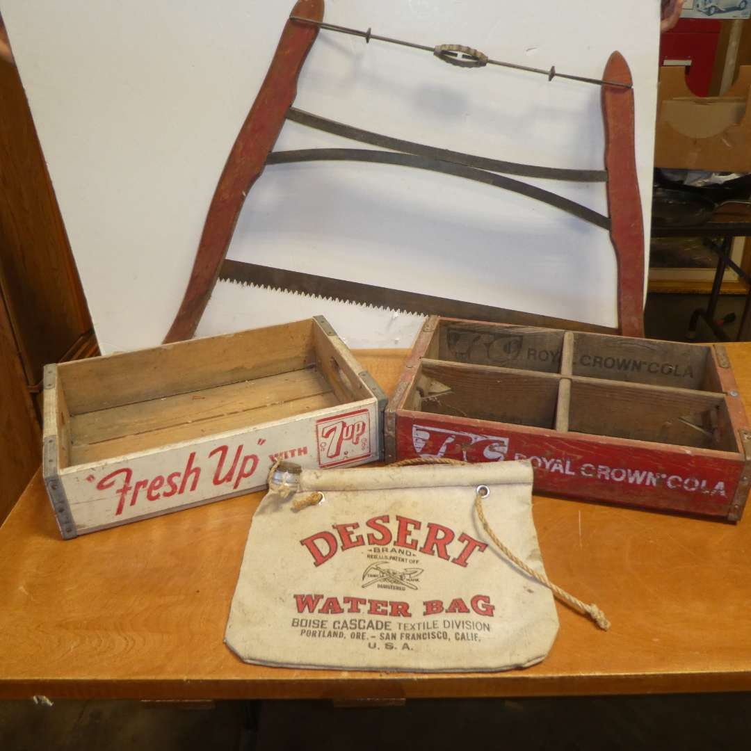 Lot # 316 -Vintage Lot - Wooden 7 UP Crate, Wood RC Cola Crate (Medford OR), Crosscut Wood Buck Bow Saw & Desert Water Bag (main image)
