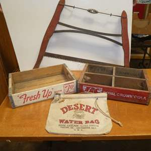 Lot # 316 -Vintage Lot - Wooden 7 UP Crate, Wood RC Cola Crate (Medford OR), Crosscut Wood Buck Bow Saw & Desert Water Bag