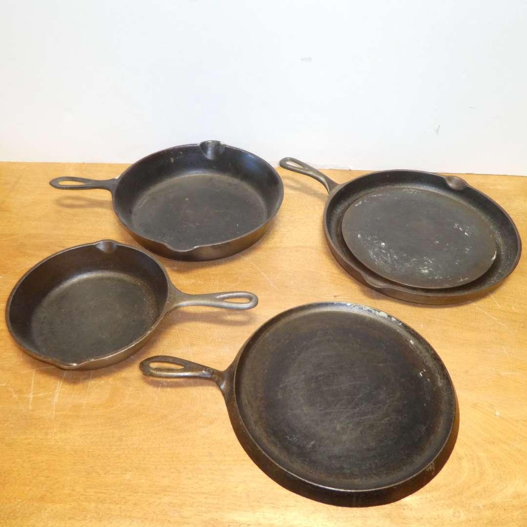 Lot # 318 - Cast Iron Lot -Vintage Wagner Ware Sydney O Pancake Griddle, Lodge Griddle & 2 Skillets  (main image)