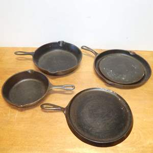 Lot # 318 - Cast Iron Lot -Vintage Wagner Ware Sydney O Pancake Griddle, Lodge Griddle & 2 Skillets
