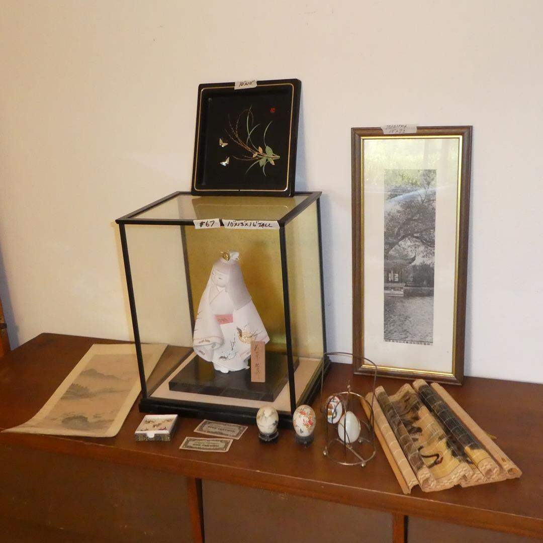 Lot # 67 - Oriental Print, Tray, Ceramic Asian Doll in Case, Painted Eggs, Framed Tapestry Print & More (main image)