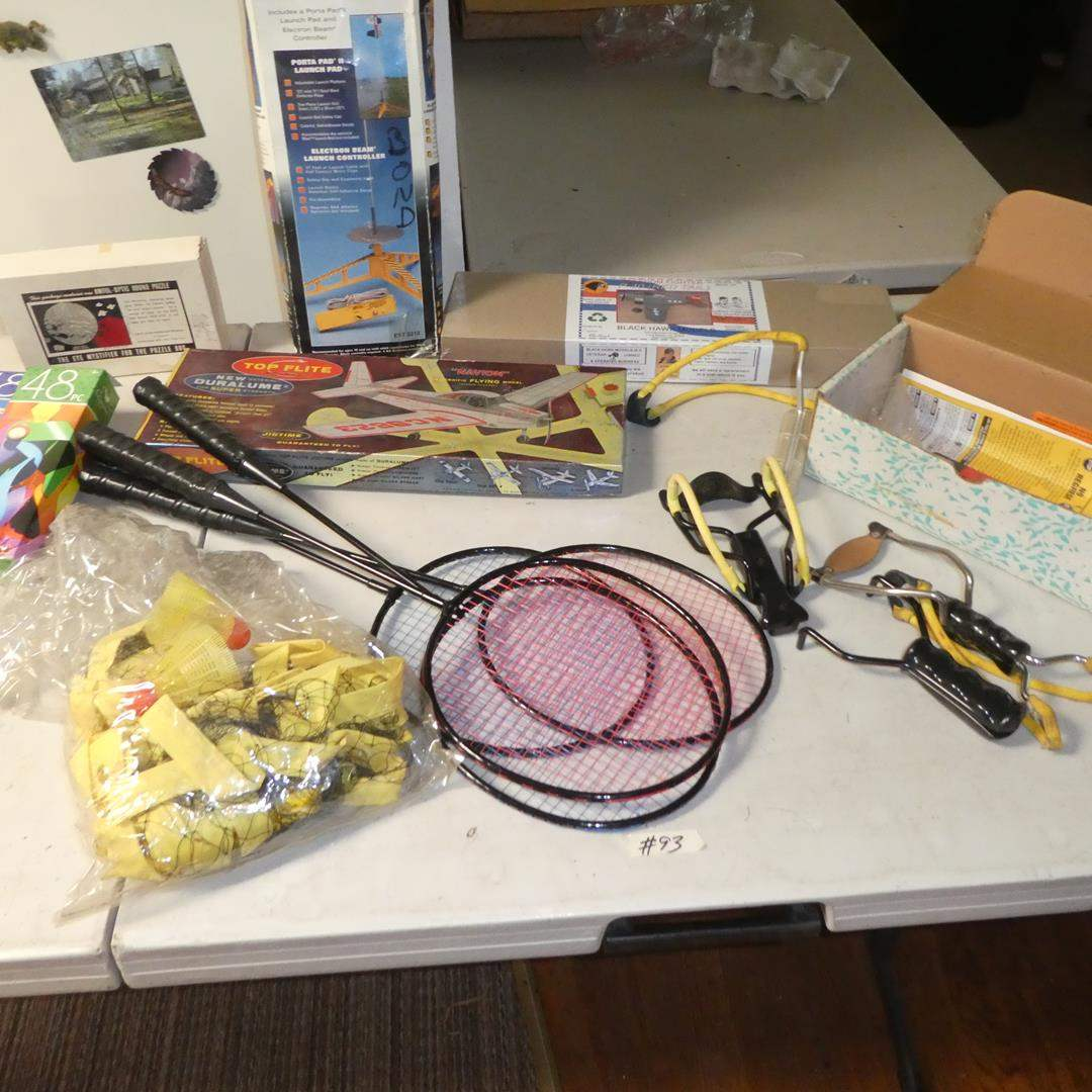 Lot # 93 - Badminton Set, Airplane Models, Model Rocket Launch System, Wrist Rocket / Slingshots & Puzzles (main image)
