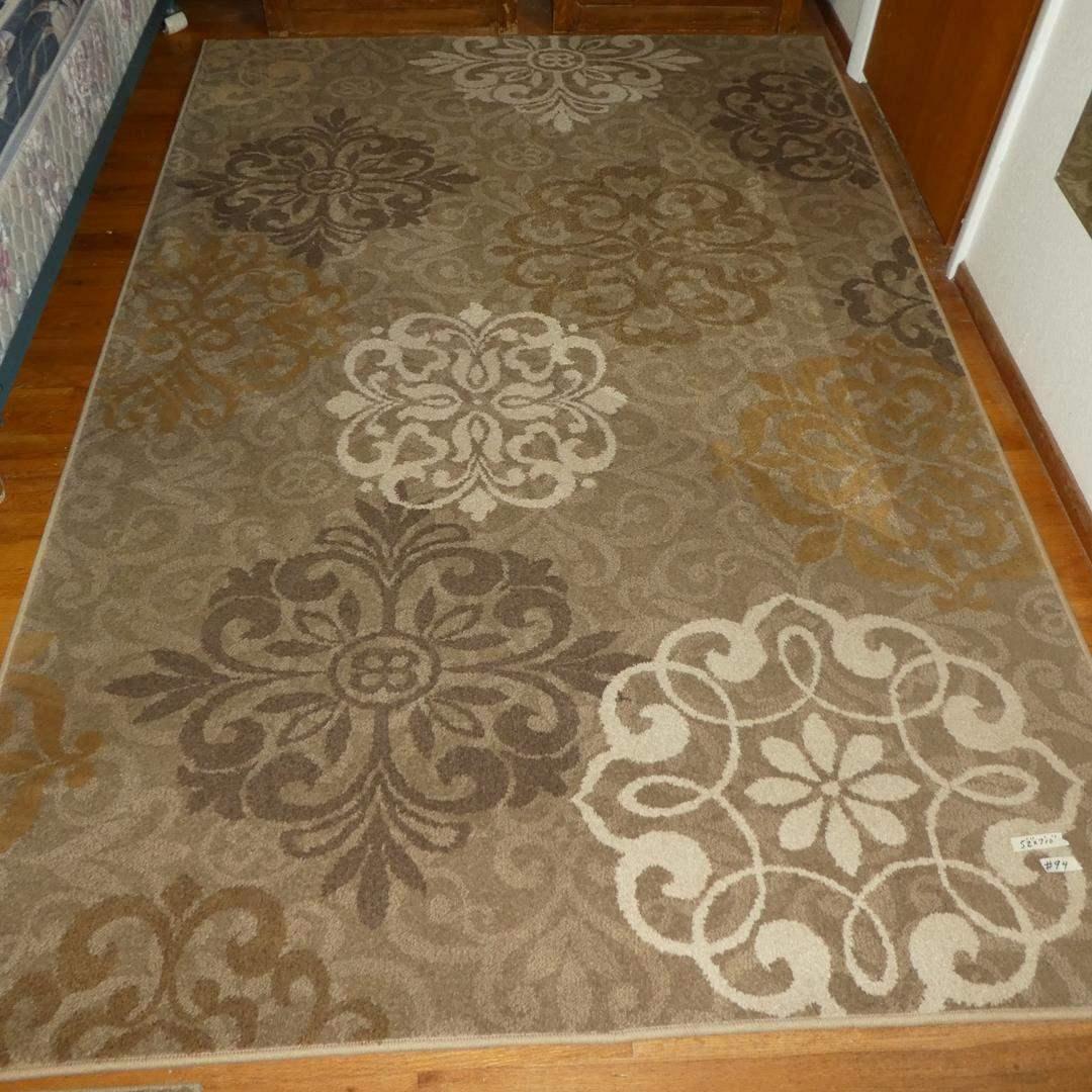 Lot # 94 - 'American Rug Craftsmen' Dark Beige Floor Rug (main image)
