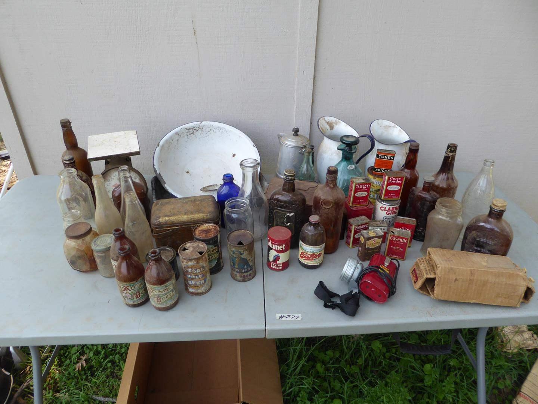 Lot # 277 - Vintage Bottles, Old Scale, Headlamp, Enamel Pitchers & Cans Collection (main image)