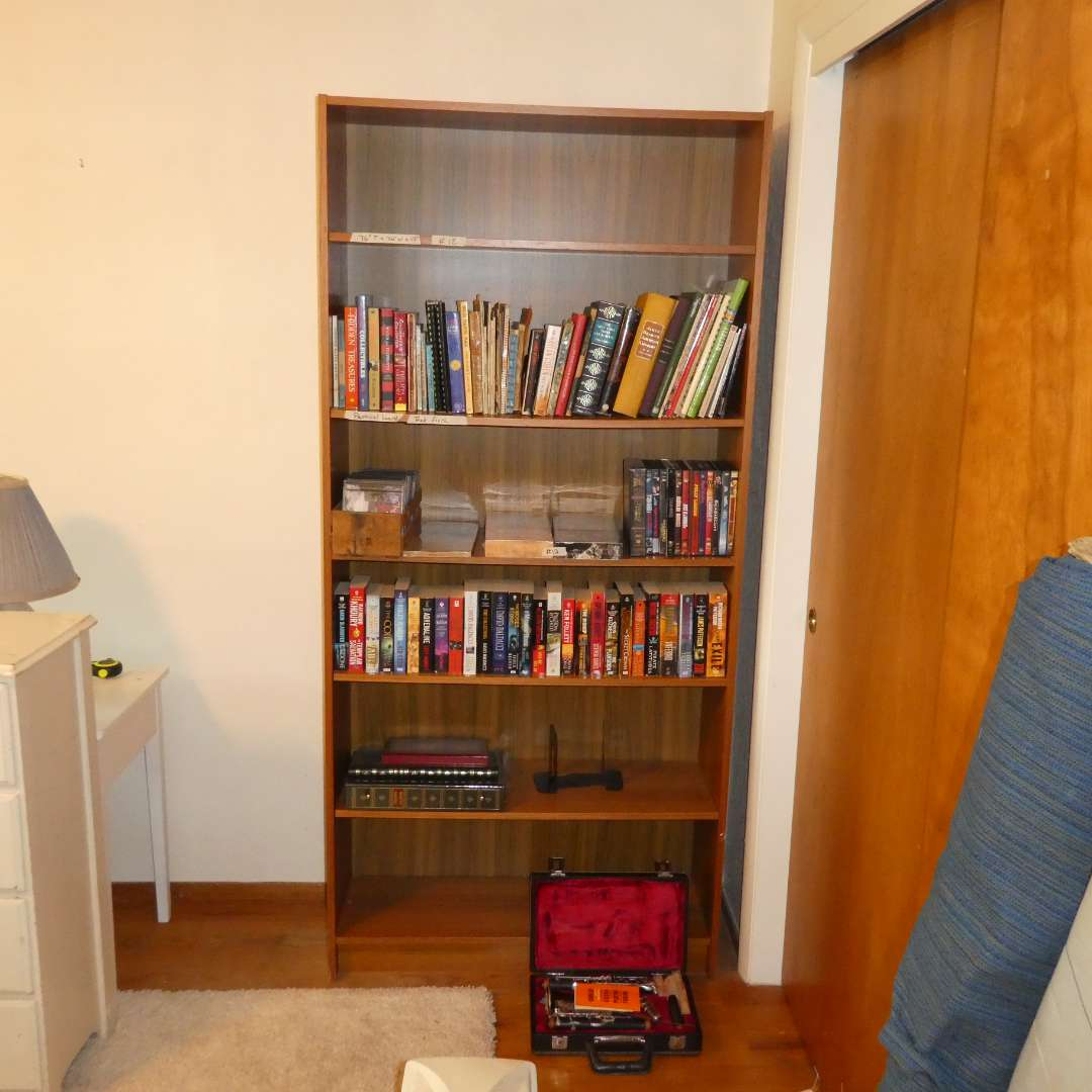Lot # 12 - Bookshelf With Various Books, CDs, DVDs, Photo Albums, And A Clarinet  (main image)