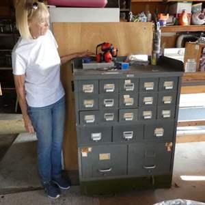 Lot # 212 - Vintage Metal File Cabinet Filled w/ Misc Hardware ( On Castors)