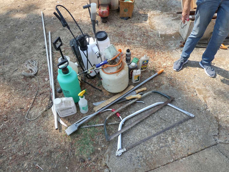 Lot # 218 - Spray Bottles, Pest Killer, And Saws (main image)