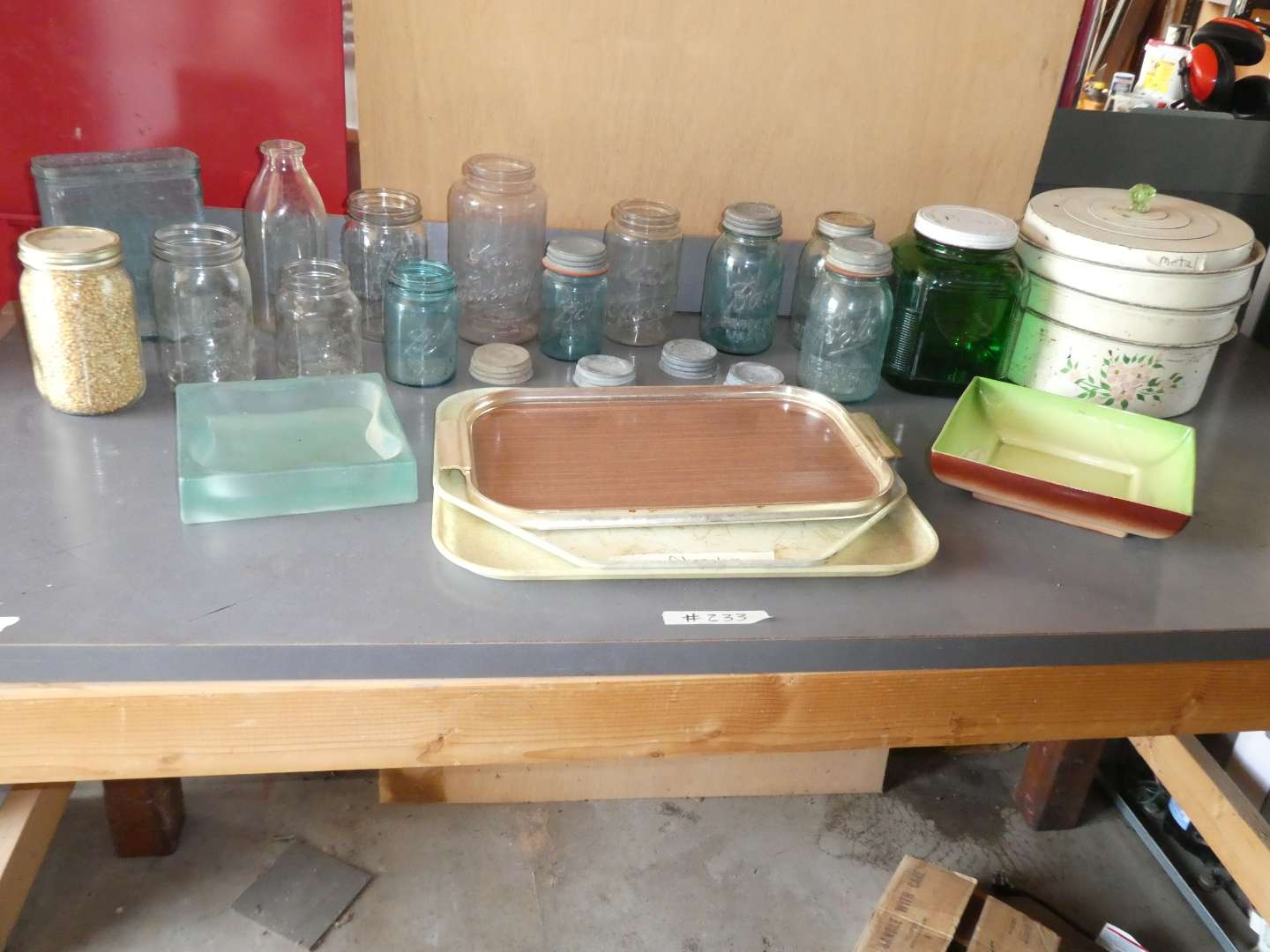 Lot # 233 - old glass jars, a metal pot, and dinner trays (main image)