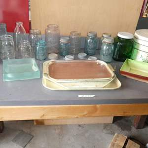Lot # 233 - old glass jars, a metal pot, and dinner trays