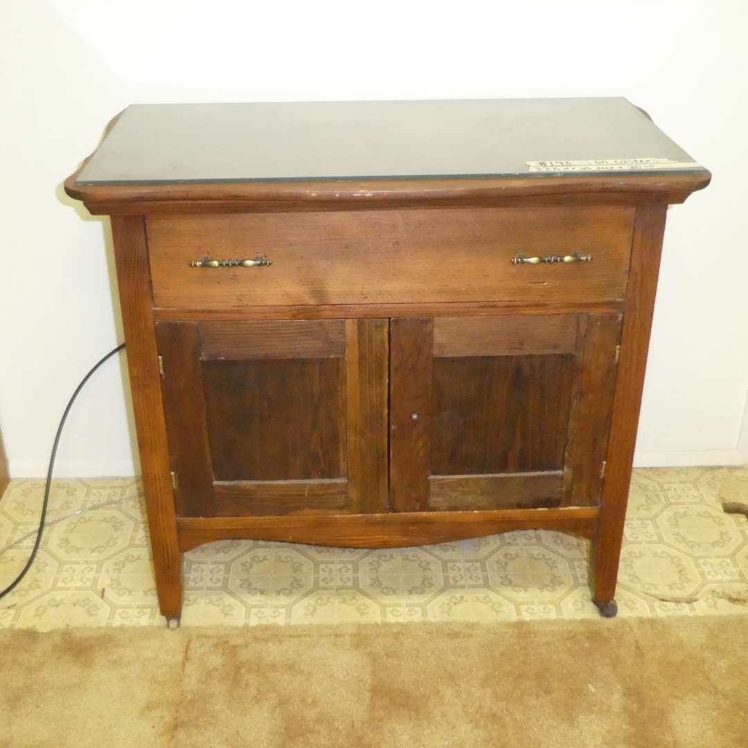 Lot # 193 - Cute Vintage Storage Cabinet On Wooden Casters (Dovetail Drawer) (main image)