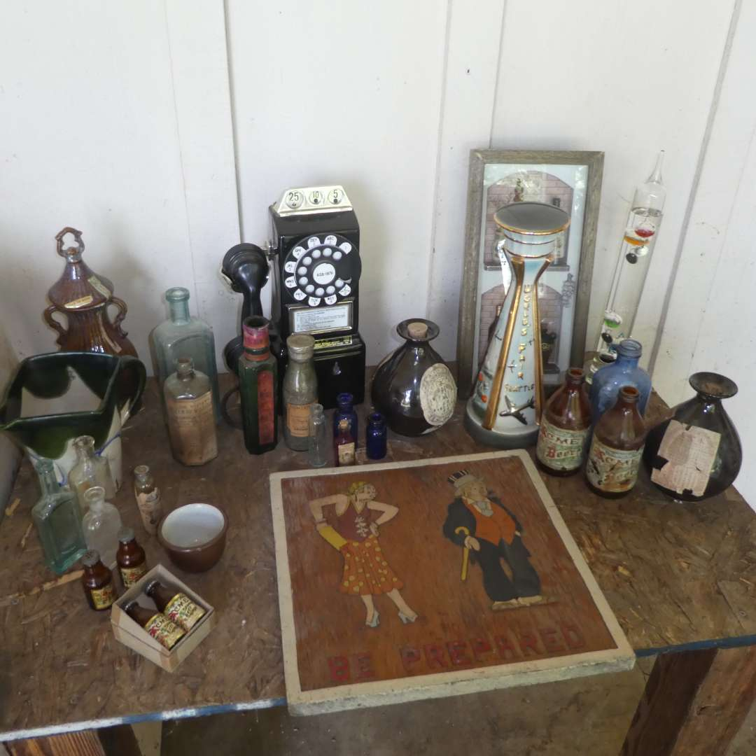 Lot # 131 -  Assorted Vintage Bottle, Decorative Decanters, Adorable Cartoon Wood Carving  & More (main image)