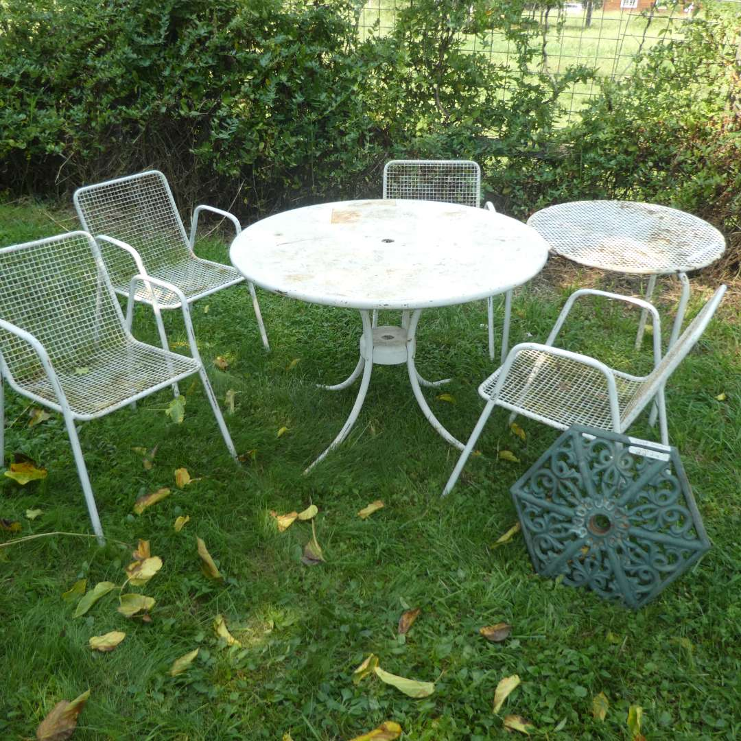 Lot # 138 -  4 Vintage Cast Metal Patio Chairs w/ 2 Different Sized Tables and Cast Iron Umbrella Stand  (main image)