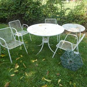 Lot # 138 -  4 Vintage Cast Metal Patio Chairs w/ 2 Different Sized Tables and Cast Iron Umbrella Stand