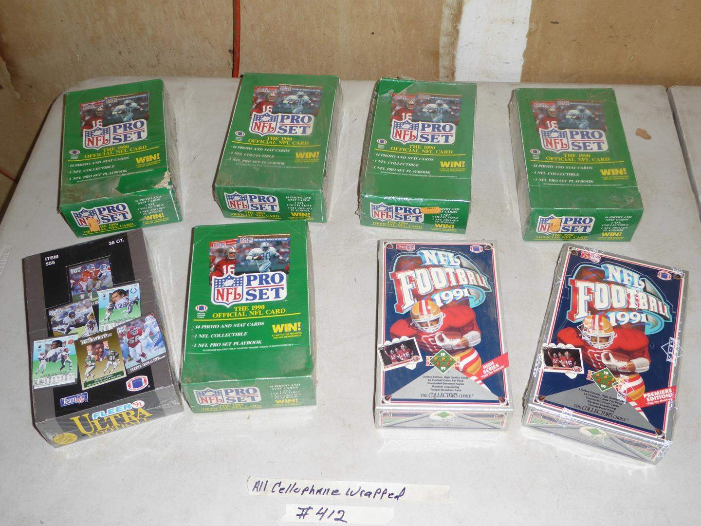 Lot # 412 - Eight Boxes Cellophane Wrapped 1990 & 1991 NFL Football Cards (main image)