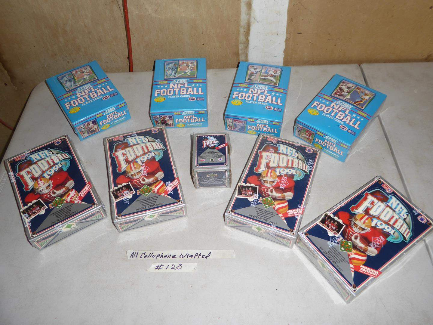 Lot # 420 - 9 Boxes Cellophane Wrapped NFL Football Cards 1990-1991 (main image)