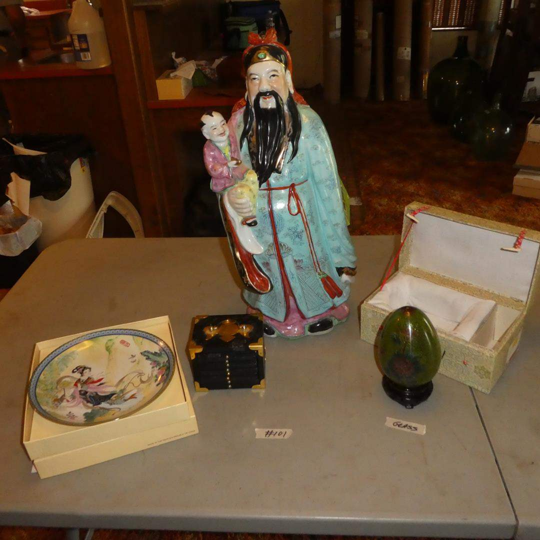 Lot # 101 - Geisha Girl Collector Plate, Asian Man Holding Child Statue, Glass Egg & Coasters (main image)