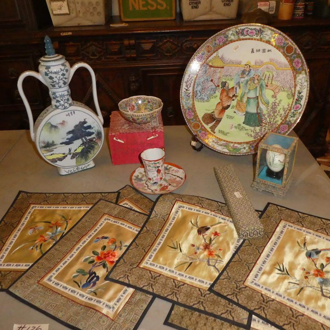 Lot # 126 - Oriental Decanter, Chinese Porcelain Bowl, Tea Cup, Decorative Plate, Hand Painted Egg, Chopsticks & Silk Placemats (main image)