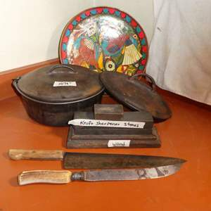 Lot # 10 - Cast Iron Pot With Knives And Sharpening Stones