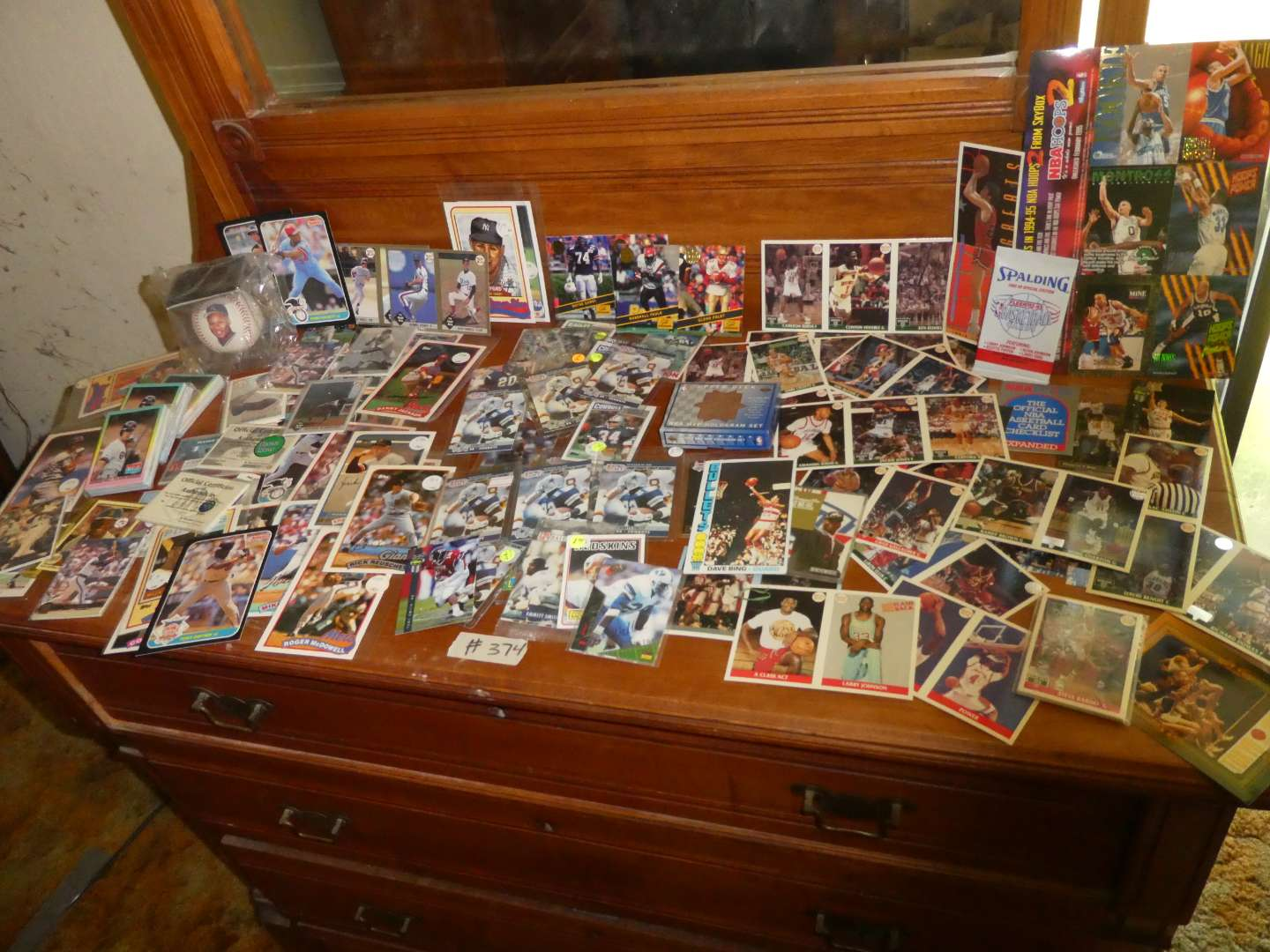 Lot # 374- Sports Memorabilia Cards From The 1980's and 1990's  (main image)