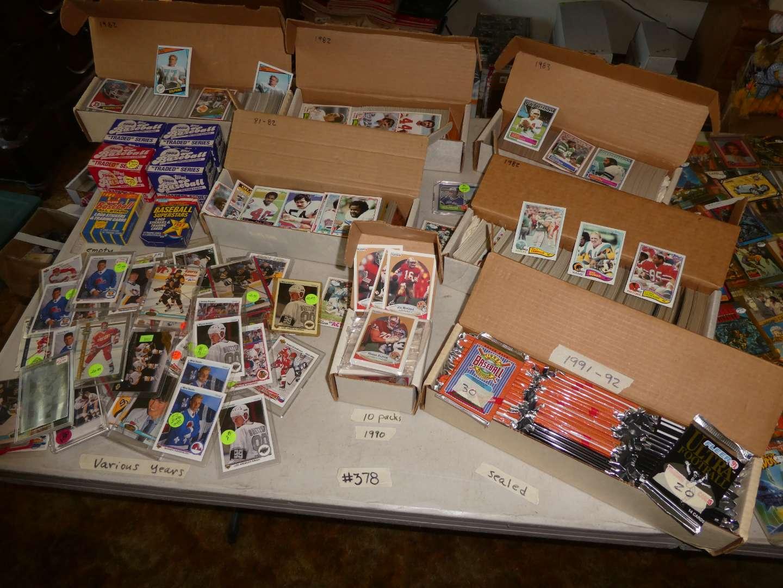Lot # 378- 1980's Football & 1990's Hockey Memorabilia Cards (main image)