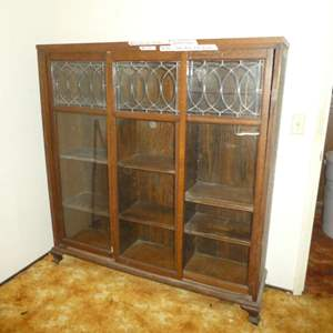 Lot # 233 - Beautiful Antique/Vintage Display Cabinet w/ Sliding Doors & Lead Glass Details (On Casters)