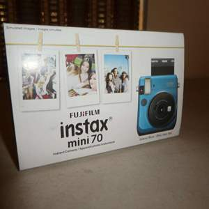 Lot # 165 - FujiFilm Instax Mini 70 (Color Blue)(New in Box)(Not Tested)