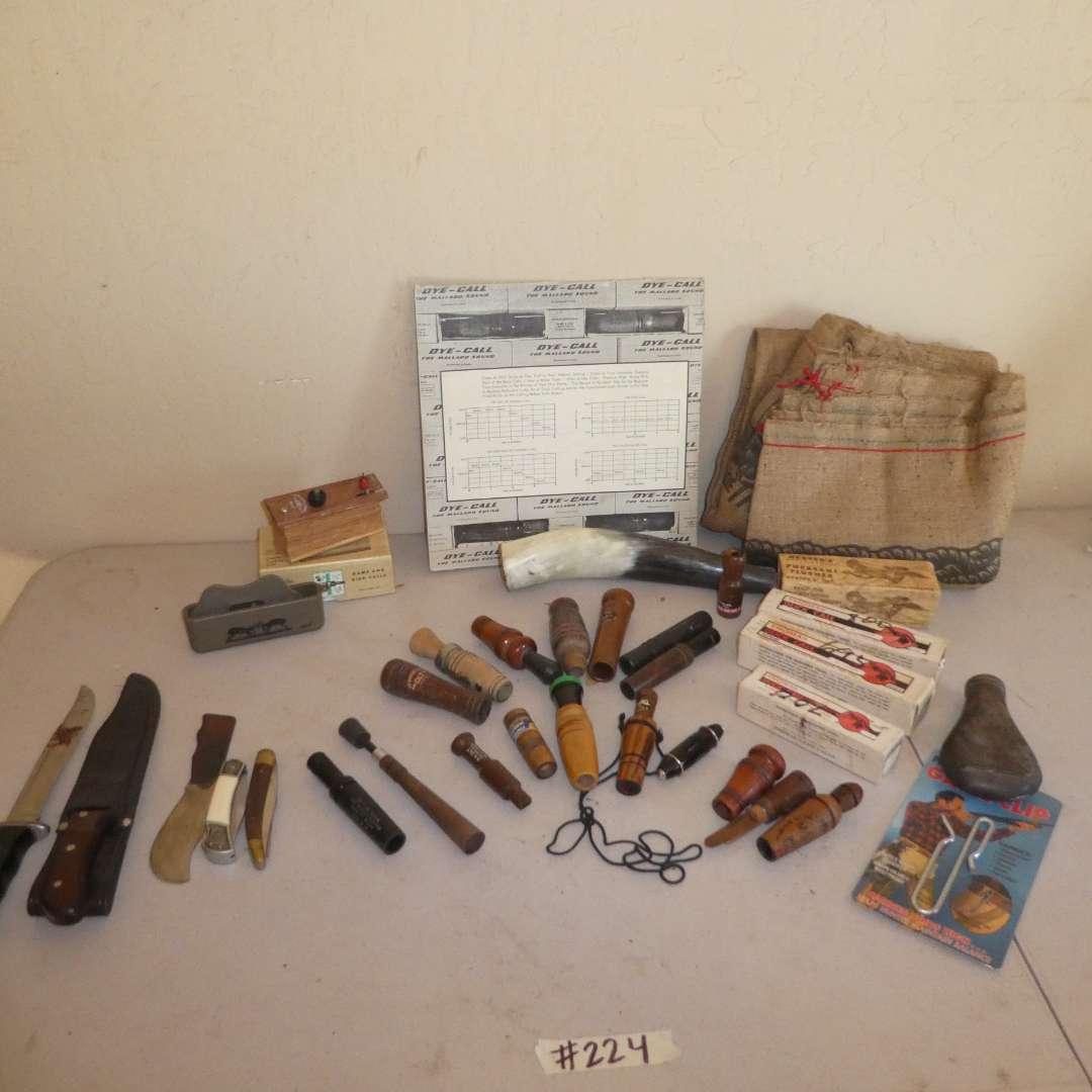 Lot # 224 - Hunting Lot - Variety of Bird Calls, Deer Sack & Knives (main image)
