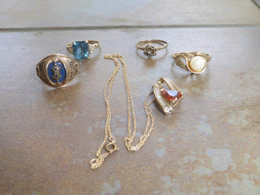 Lot # 304 - Ladies 10K Gold Rings & 10K Gold Pendant (main image)
