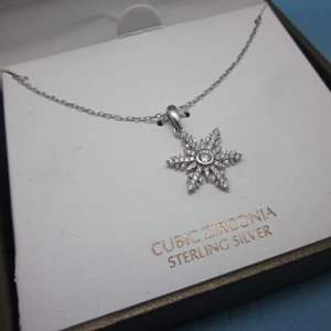 Lot # 5 - Cubic Zirconia Sterling Silver Necklace with a Snowflake Pendant