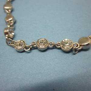 Lot # 14 - Double Strand Tiered Silver Tone, Diamond Looking Necklace