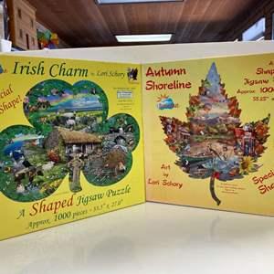 Lot # 11 - 2, SunsOut, Shaped 1000 Piece Puzzles - Irish Charm & Autumn Shoreline