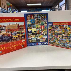 Lot # 14 - 3 -1000 Piece Puzzles - Barnyard Gems, Travel USA (Vintage Posters), Roadside America