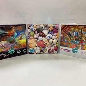 Lot # 17 - 3, 1000 Piece Puzzles: Spirit of Flight, Seashore, & Grandma's Attic
