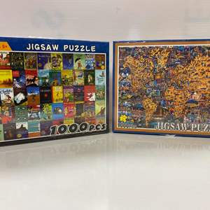 Lot # 20 - 2 Jigsaw Puzzles 1000 Pieces: World Atlas & Movie Posters
