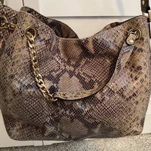 Lot #9- Authentic Michael Kors Handbag, gently used, a few spots inside.