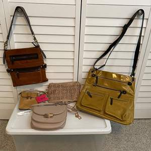 Lot #10- Vegan Crossbody Purses (gently used in great shape), Two Never used Crossbody Tag on. Madison West Crossbody.