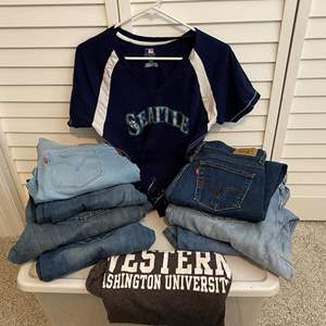 Lot # 12- Seven Pairs of Jeans: Levis, Citizen of Humanity, Lee. See Tag Pics for Sizes. T-Shirts.