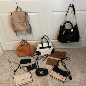 Lot # 18- Assortment of Cute Handbags and Wallets. Some not used and some are used. * Michael Kors * Kate Spade*