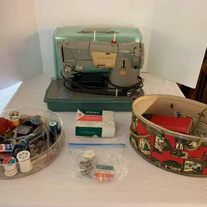 Auction Thumbnail for: Lot #87 - Vintage Singer Sewing Machine in Carrying Case with Several Sewing Notions and Supplies
