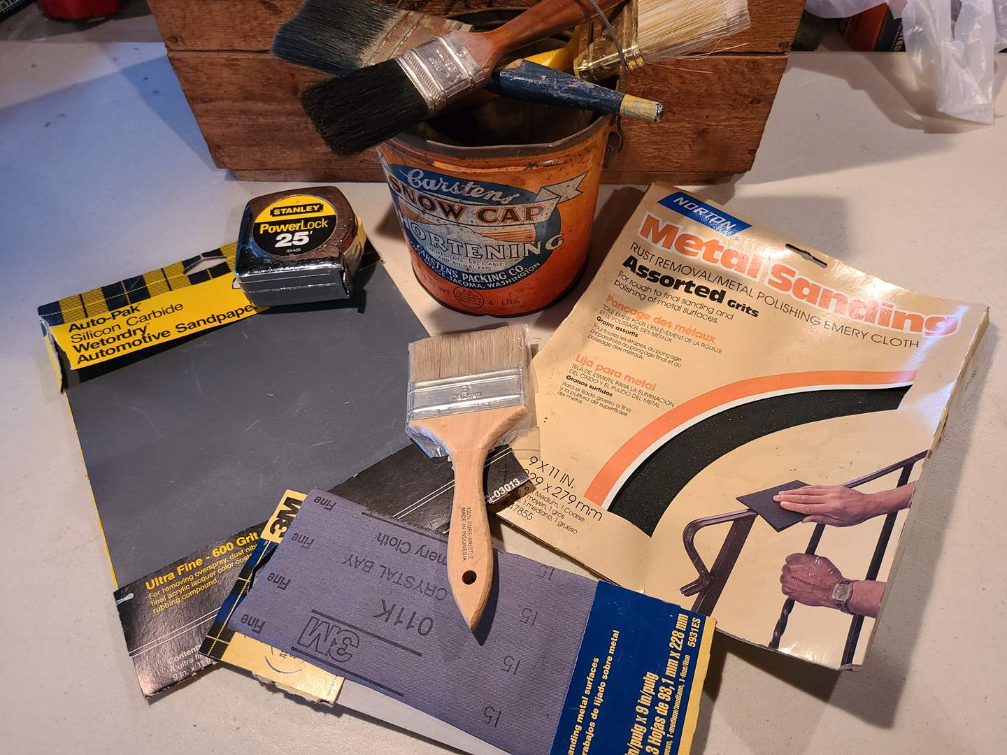 Lot# 22 - Vintage Snow Cap tin Can full of painting supplies * Brushes * Tape Measure * Sandpaper (main image)