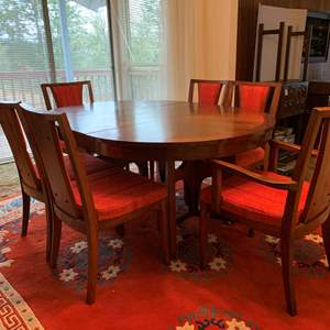 Lot #29 - Distinctive Mid Century Modern Dining Set, 6 Upholstered Chairs, Pads, 1 Leaf, On Casters