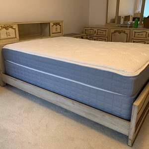 "Lot #66 - King Size Bed and Serta Mattress Set. Carved Sliding Door Headboard, ""Secret"" Side Doors"