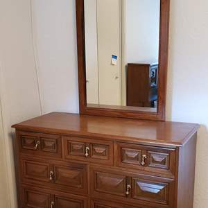 Auction Thumbnail for: Lot #77 - Vintage Wood 7 Drawer Dresser with Mirror and Brass Hardware