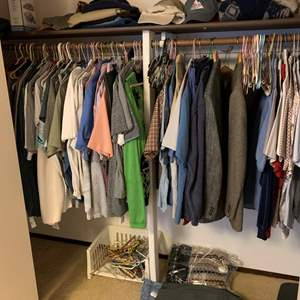 Lot #141 - Closet Full of Men's Clothing, Casual and Dress Shirts, Pants And Hats, Mostly Size Large