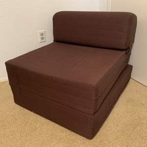 Lot #144 - Folding foam Futon Sleeper Chair, Folds Into Twin Size Foam Bed