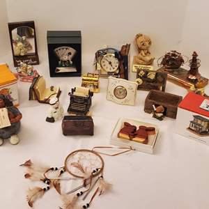 Lot #196 - An Assortment of Curios: Wood Bunnies, Resin, Mini Clocks and More