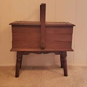 Lot #198 - Vintage Sewing Cabinet with Carved Top 22x12x20H, and a Few Notions