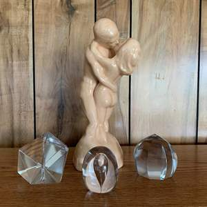 Lot #247 - Three Glass Paperweights and  Ceramic Embracing Couple
