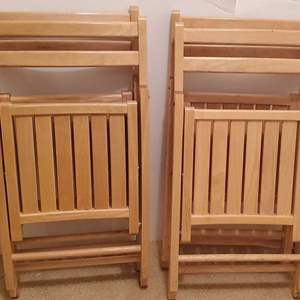 Lot #282 - Four Blond Wood Folding Chairs