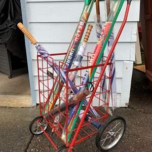 Lot #307 - Easy Wheels Cart Full of Umbrellas and Beach Umbrellas